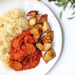 Vegetarische curryworst met zuurkool en aardappel